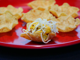 Taco appetizer topped with cheese