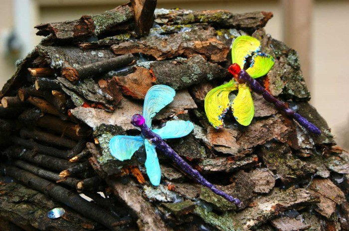 Dragonflies on the fairy house roof