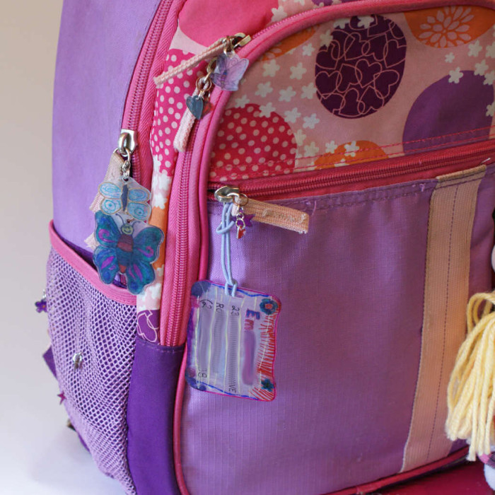Backpack with Shrinky Dink ID tag and shrink plastic zipper pulls