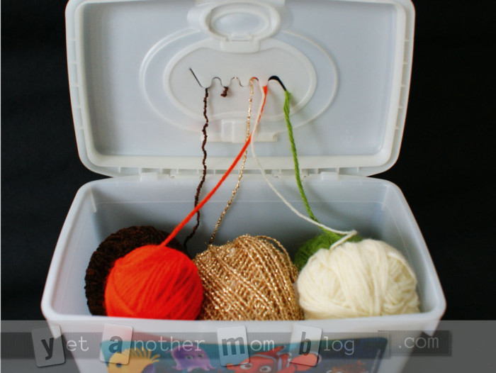 Baby wipes organizer for balls of yarn